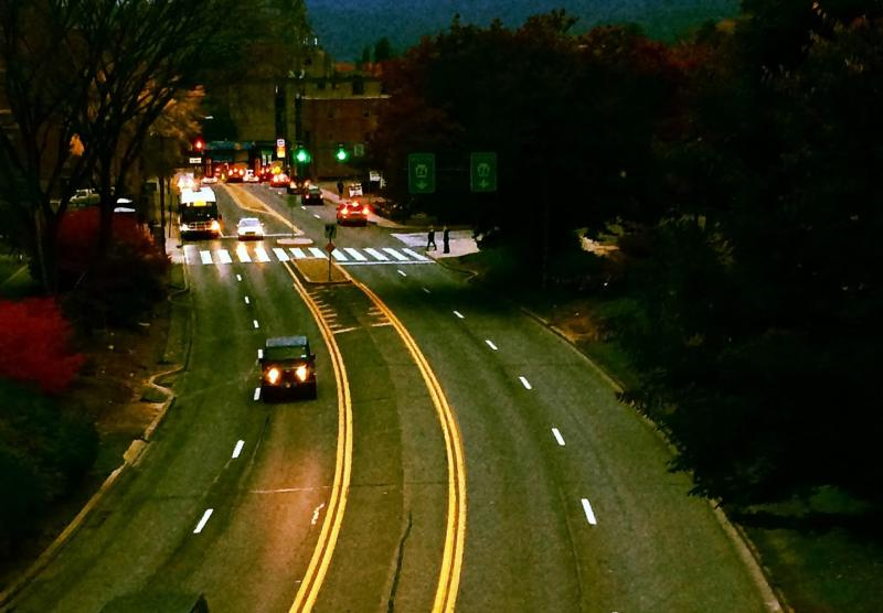 A wide angle shot of traffic at night in downtown State College